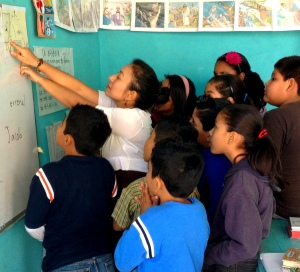 Children getting a geography lesson at Iglesia Getsemani in Morelos