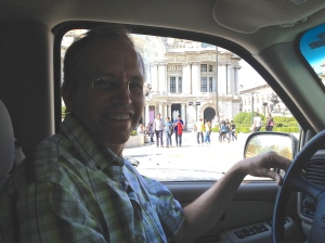 Chris driving in our commute past Bellas Artes!