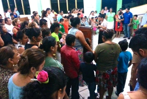 Families in Comalcalco praying for God's guidance and restoration