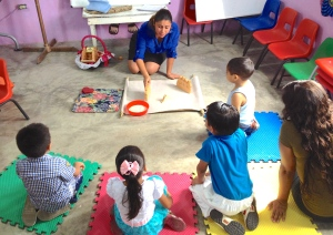 "Zoila telling God's story to the little ones using AMO's ""Wellspring of Wonder"" ~ Villahermosa, Tabasco"